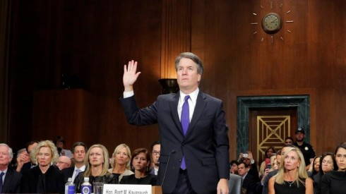 FILE PHOTO: U.S. Supreme Court nominee Brett Kavanaugh is sworn in to testify at Senate Judiciary Committee confirmation hearing on Capitol Hill in Washington